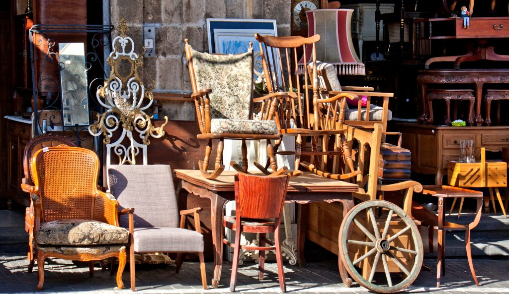 collection of antique furniture for sale, a common sight at the best flea markets in texas like the round top antiques fair