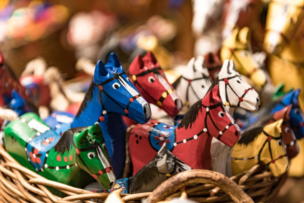 painted wood-carved horses. handcrafted goods like this are common at the best trade days in texas