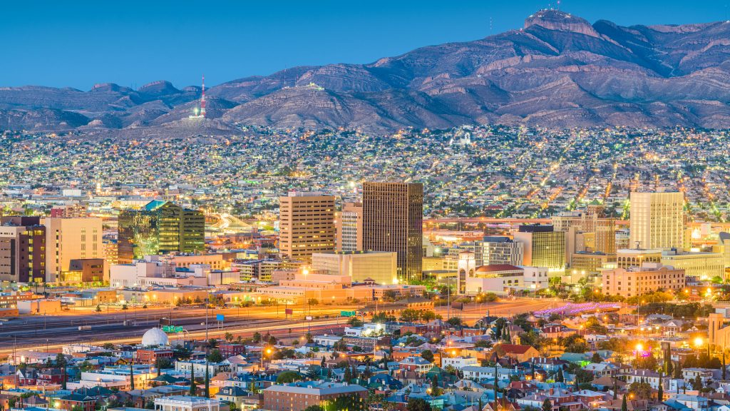 skyline of el paso at night with mountains in the background. there are lots of fun things to do in el paso tx