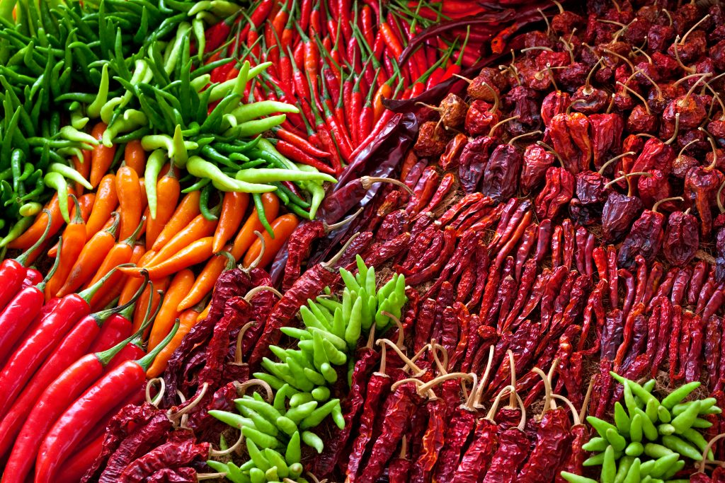 selection of chilis for sale in the food section of a texas trade days
