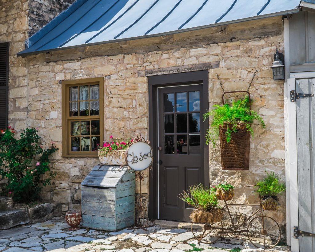 limestone cottage with a steel roof in fredericksburg tx. when deciding where to stay in fredericksburg you have plenty of options