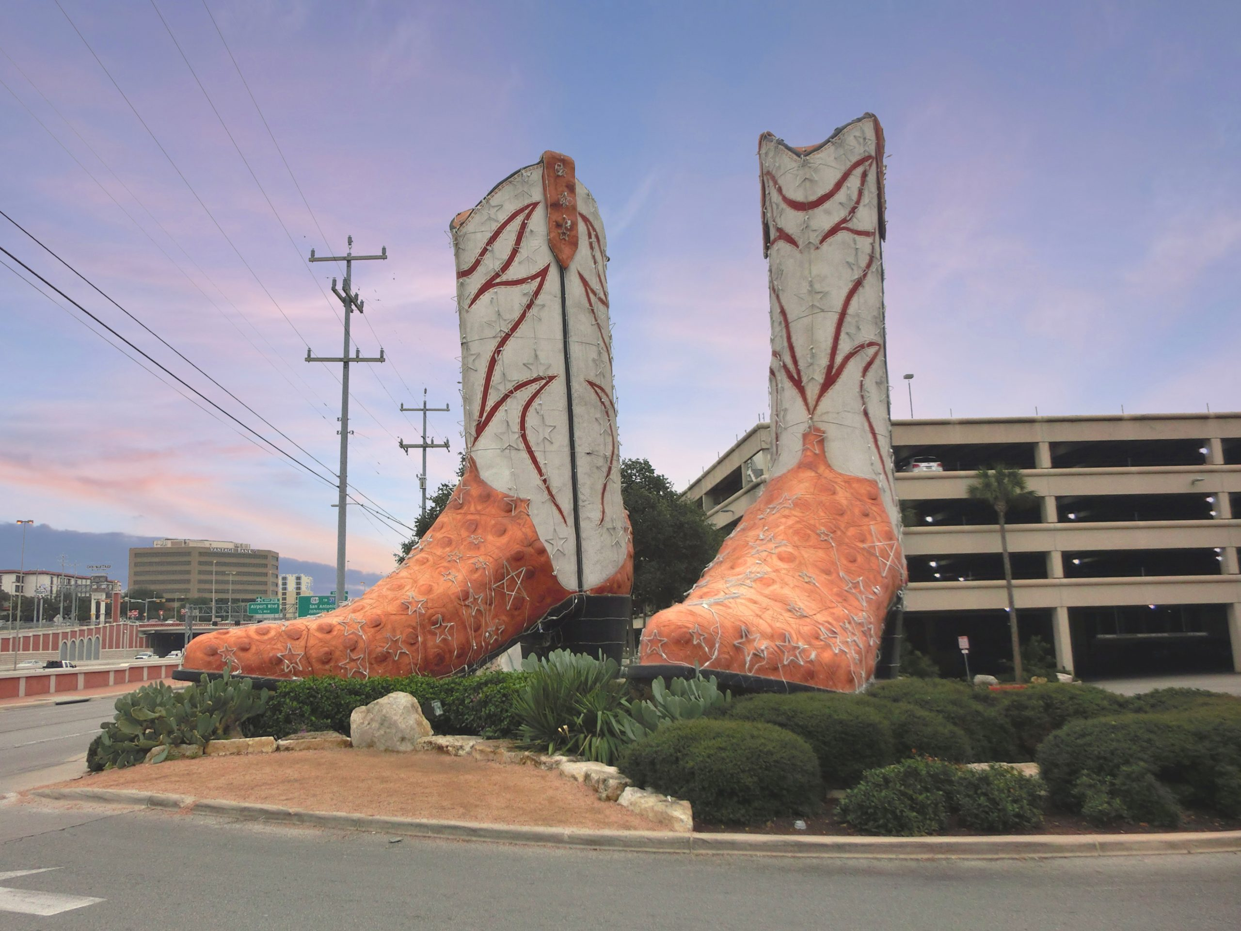 35-foot tall cowboy boots in front of north star mall san antonio, one of the weird roadside attractions in texas