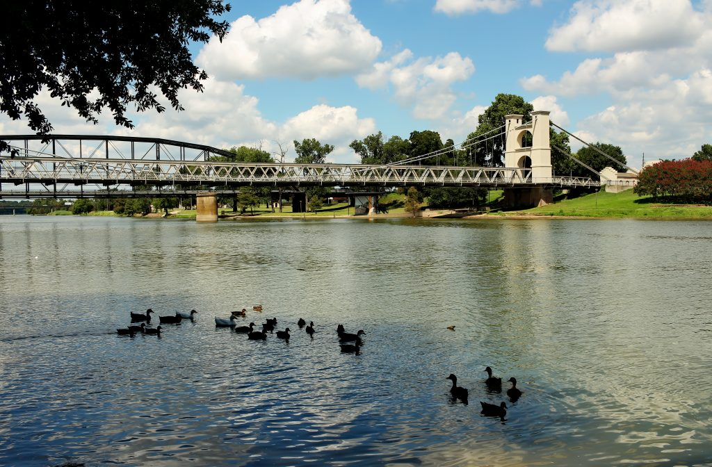 bridge along the brazos river in waco tx, a common stop on a san antonio to dallas road trip