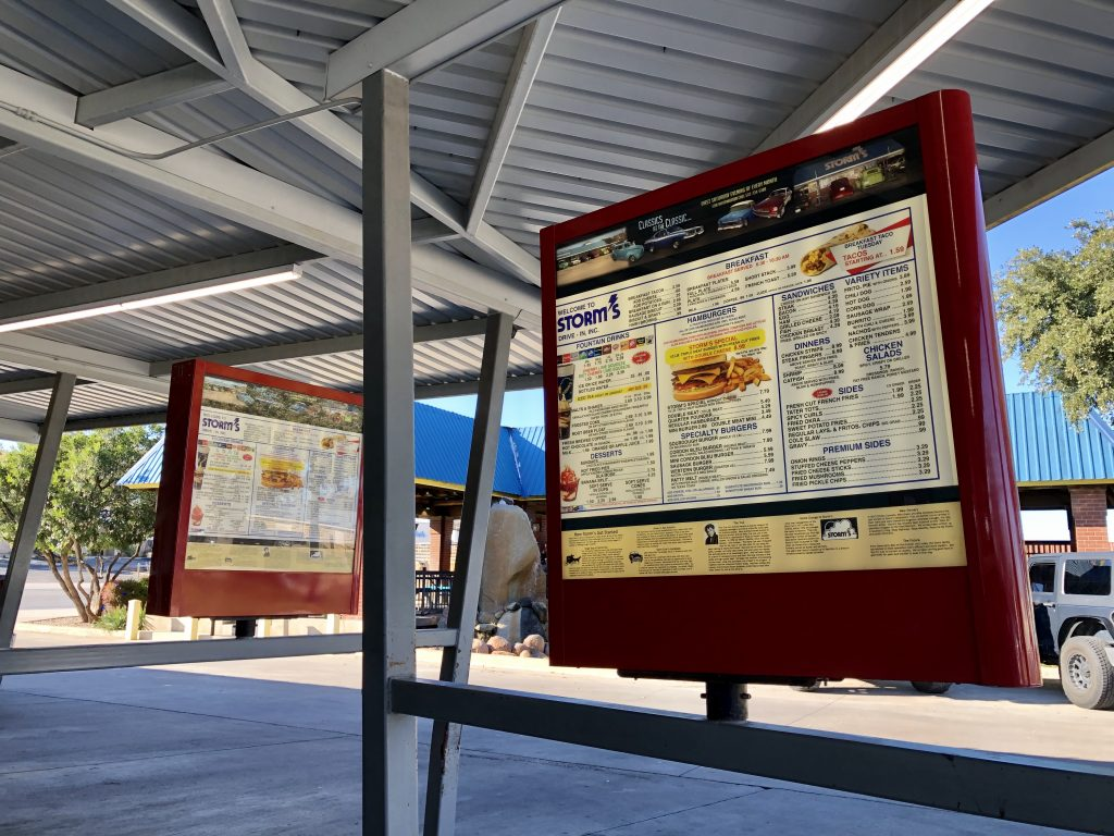 photo of drive in menus at storms drive in, one of the best places to visit in lampasas texas