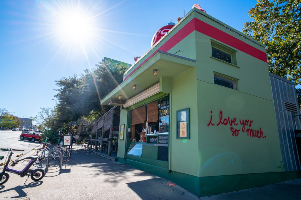"jo's coffee on south congress with ""i love you so much"" on the side of the building"