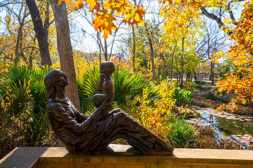 statue of a woman holding a child in the umlauf sculpture garden on a fall day, a great stop during 3 days in austin