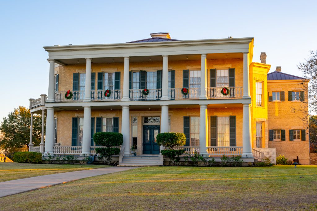 exterior of giddings stone mansion in brenham tx things to do in