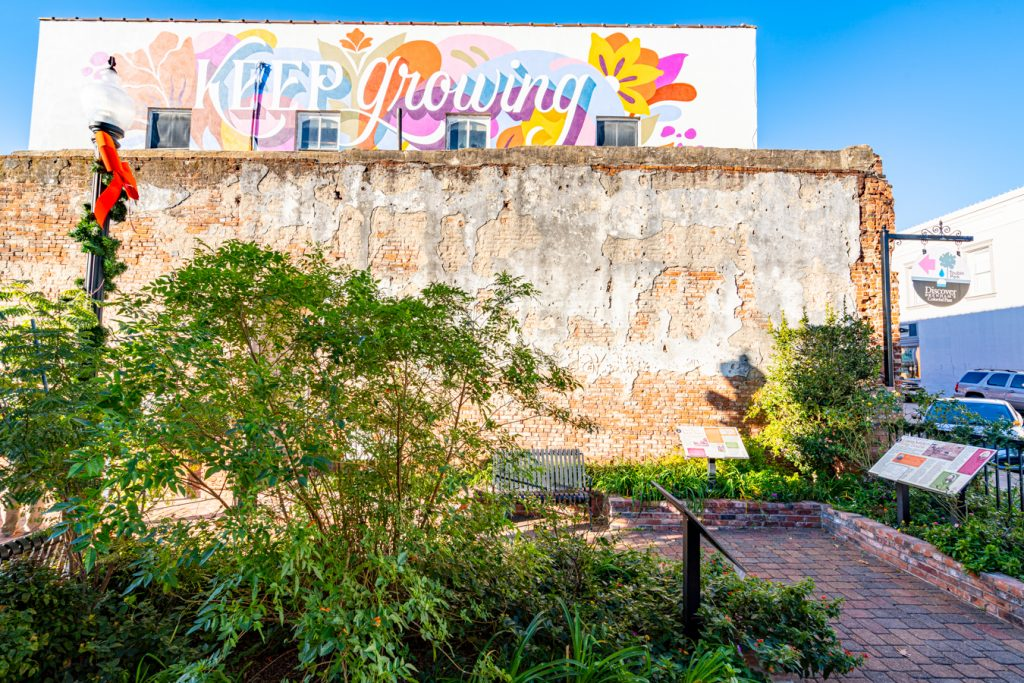 """toubin pocket park with """"keep growing"""" mural in the background, what to do brenham tx"""