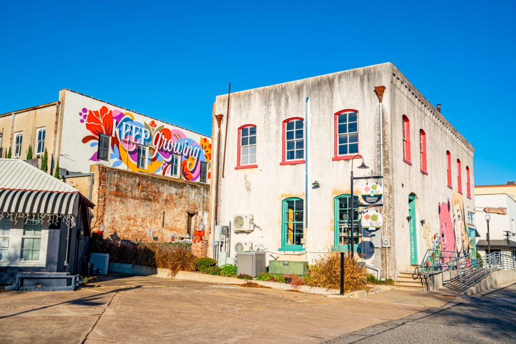 photo of downtown brenham with 2 murals visible, enjoying the murals is one of the best things to do in brenham texas