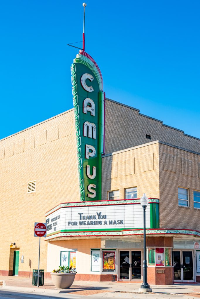 historic green sign for campus theatre