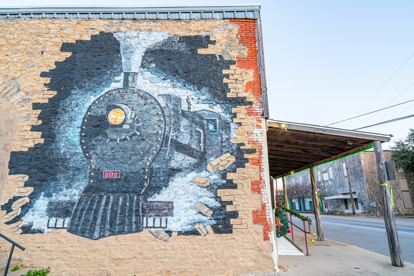 mural of an old fashioned train painted on a brick wall in dublin tx, one of the best day trips from fort worth texas