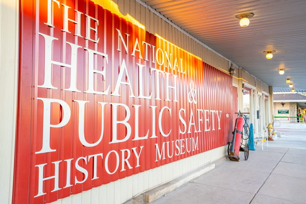 "red and white lettering on exterior of metal building reads ""the national health and public safety history museum"""