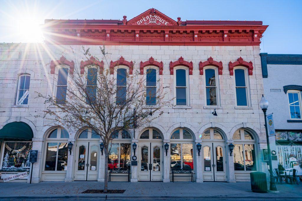 front facade of granbury texas opera house with sun flair