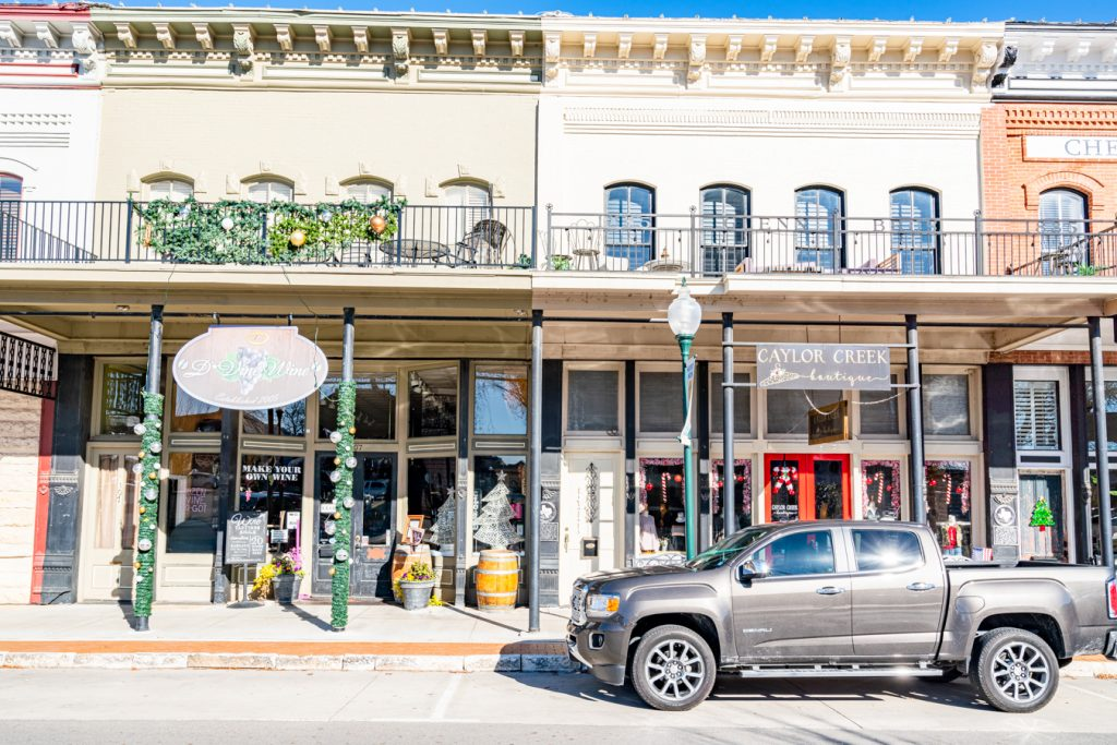 collection of shops in downtown granbury square, one of the best things to do in granbury tx