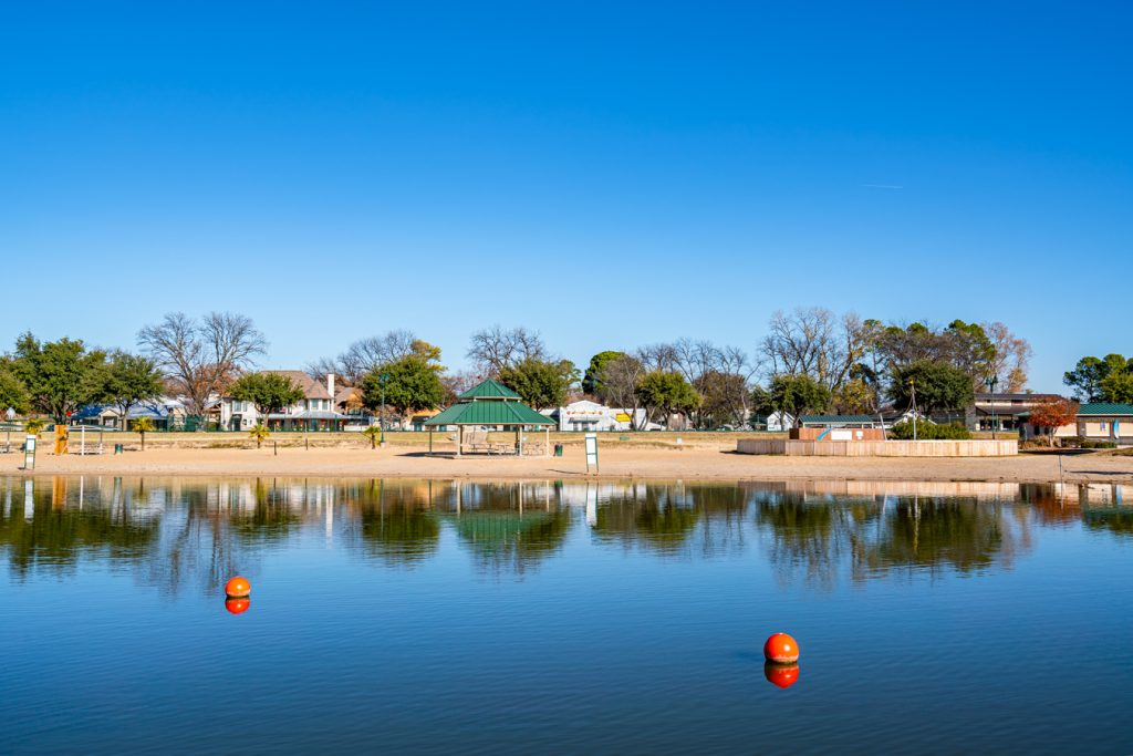 city beach park as seen from across the water, belongs on any list of what to do in granbury texas