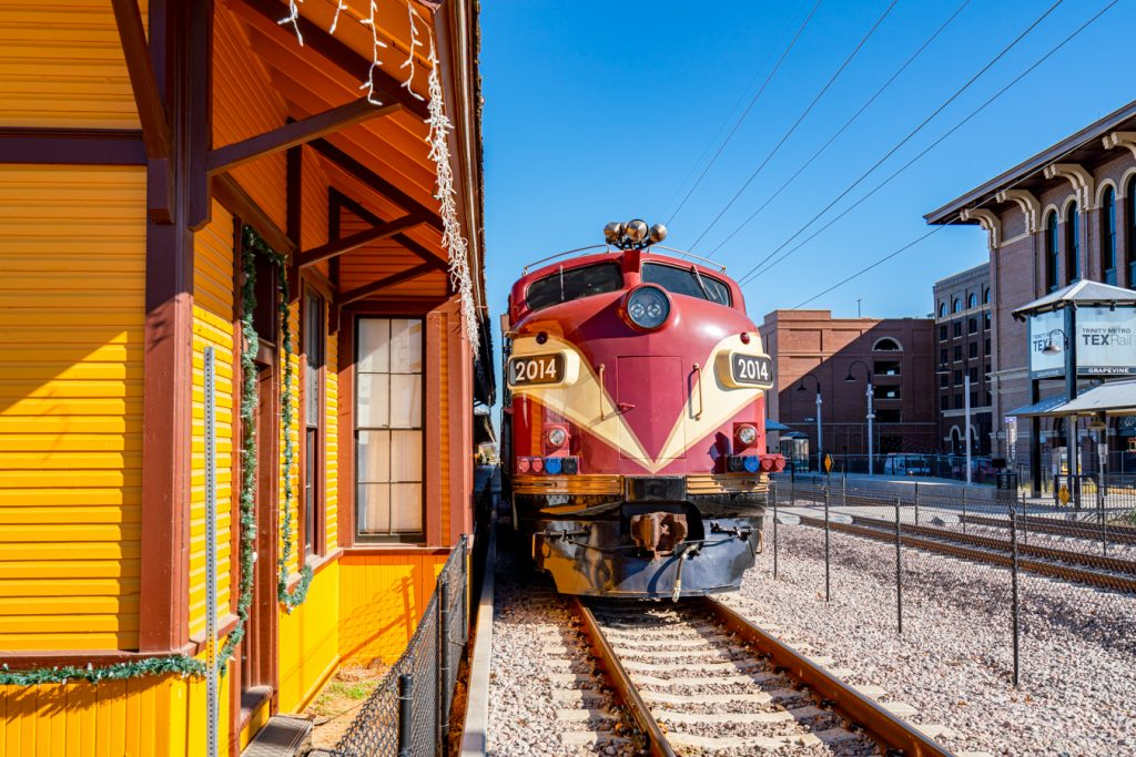 train parked at yellow grapevine railroad station, one of the best things to do in grapevine tx