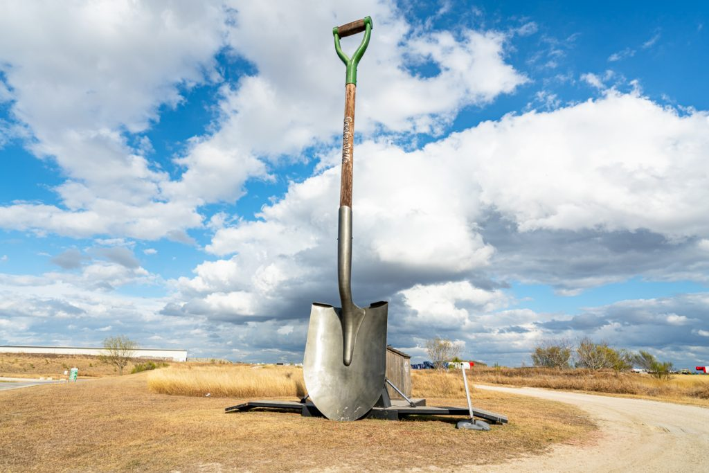 world's largest shovel in creedmore on a partly cloudy day, one of the weird roadside attractions texas