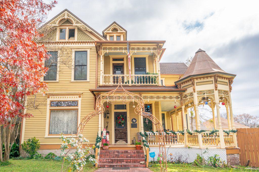 historic yellow victorian home on washington ave in navasota texas