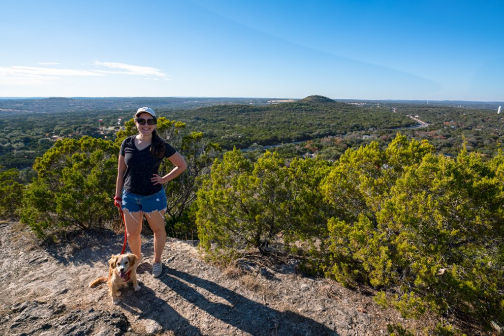 Kate Storm with her puppy Ranger Storm on top of Mount Baldy, one of the best wimberley tx things to do