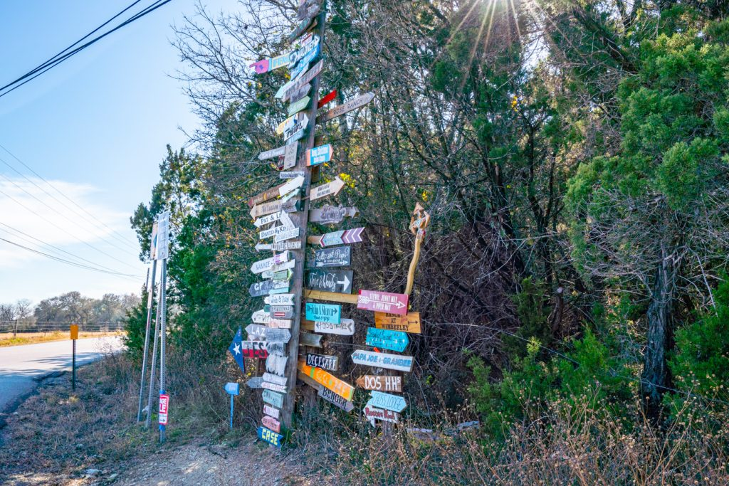 colorful signs in wimberley near jacobs well natural area