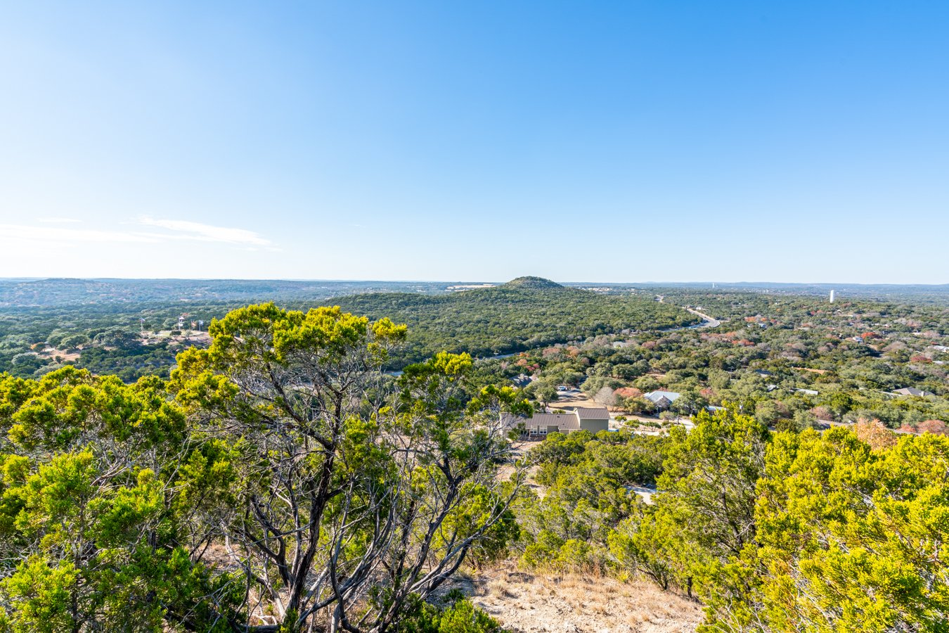 view of texas hill country from above at old baldy wimberley prayer mountain