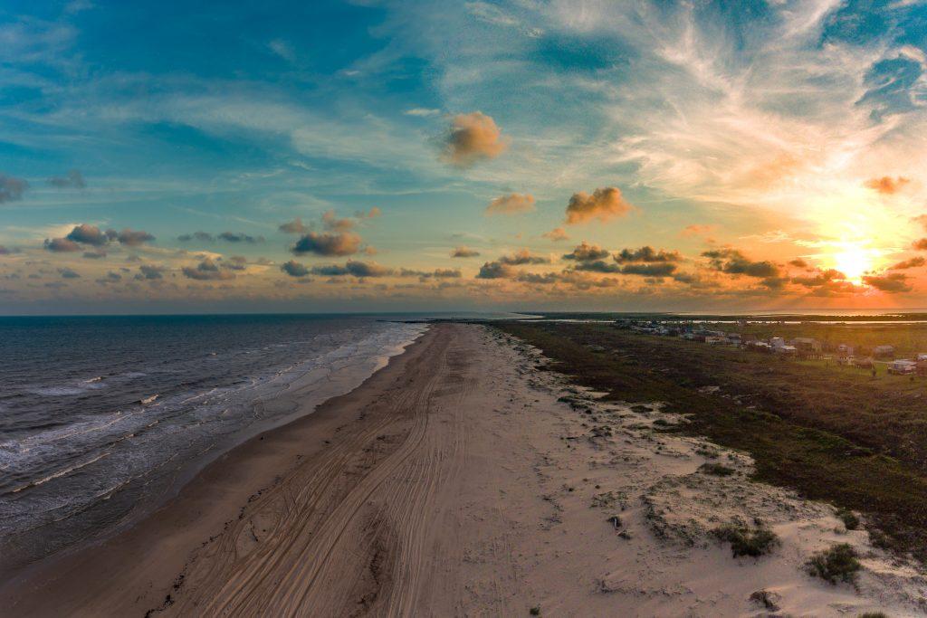 view of matagorda beach close to houston tx at sunset