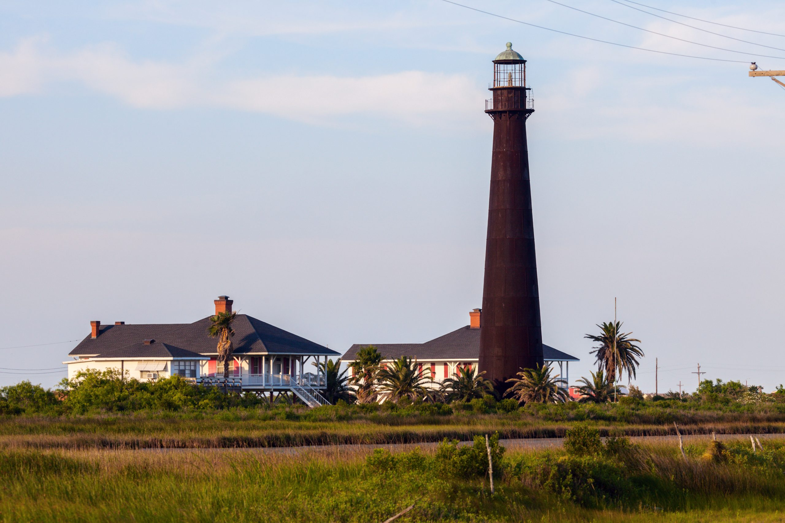 black point bolivar lighthouse with keepers cottages, one of the best texas lighthouses to visit