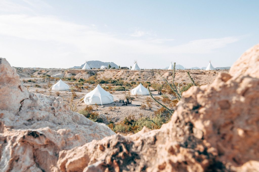 overview of glamping campground with white tents in west texas
