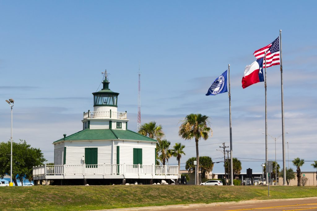 hexagonal half moon reef ligthouse with green roof, one of the best lighthouses in texas