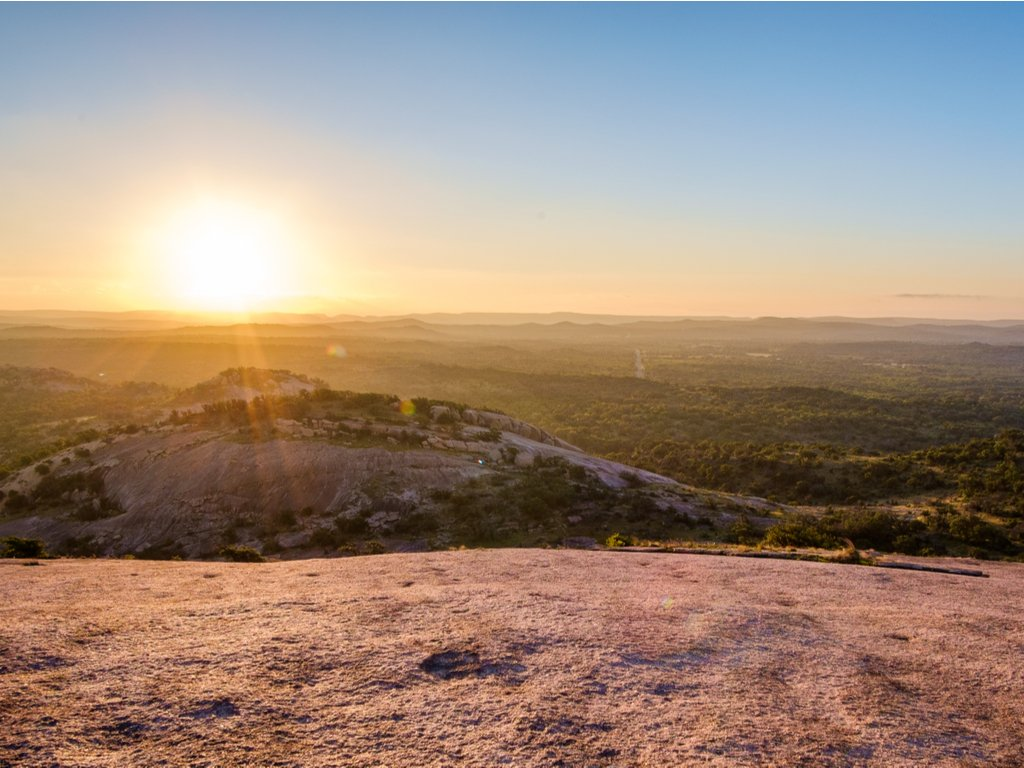 sunrise over enchanted rock texas as viewed after completing the summit trail enchanted rock hike