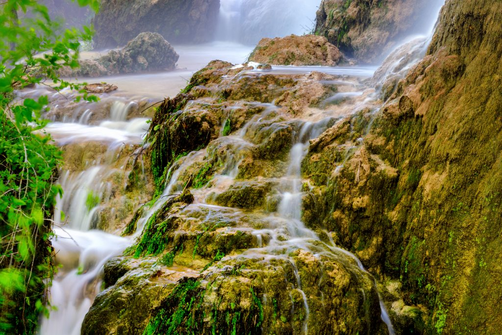 close up of gorman falls in colorado bend, one of the best texas state parks near austin tx