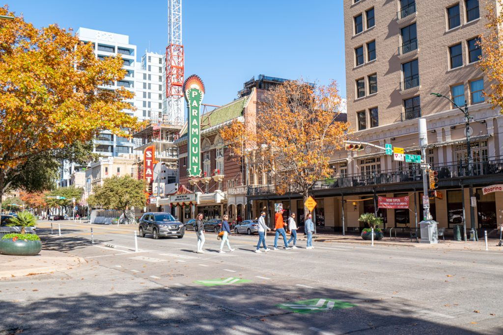 paramount theater in downtown austin texas with visitors crossing the street in front of it
