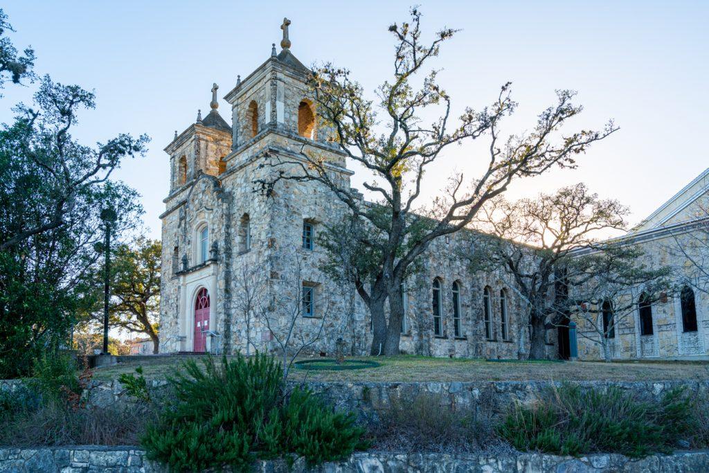limestone church on a hill overlooking boerne tx