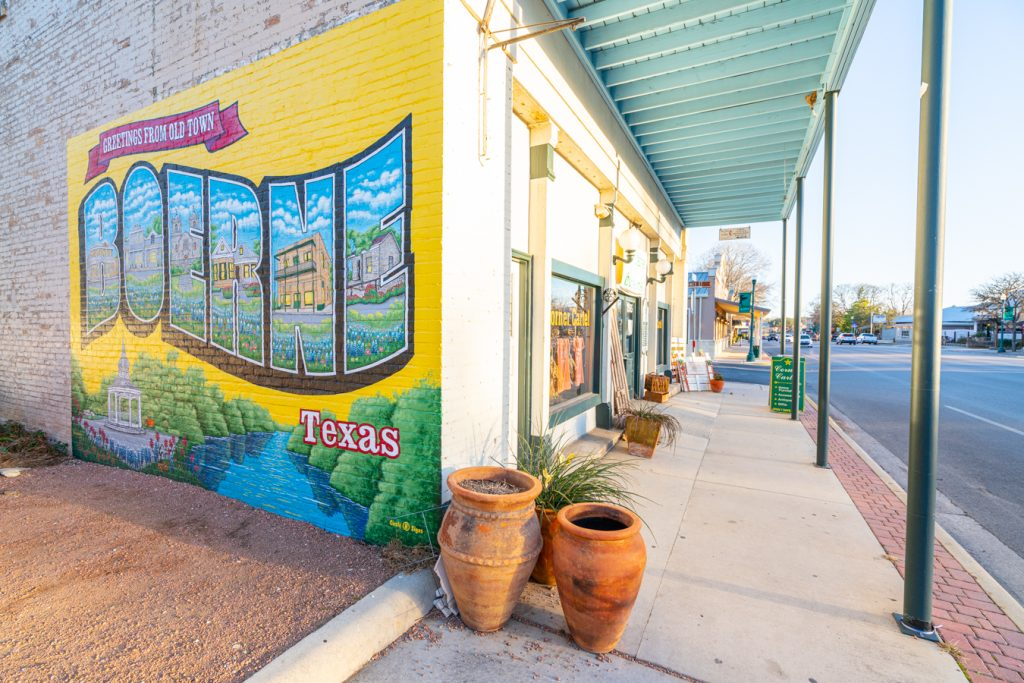 mural in booerne texas, painted on the isde of a brick building