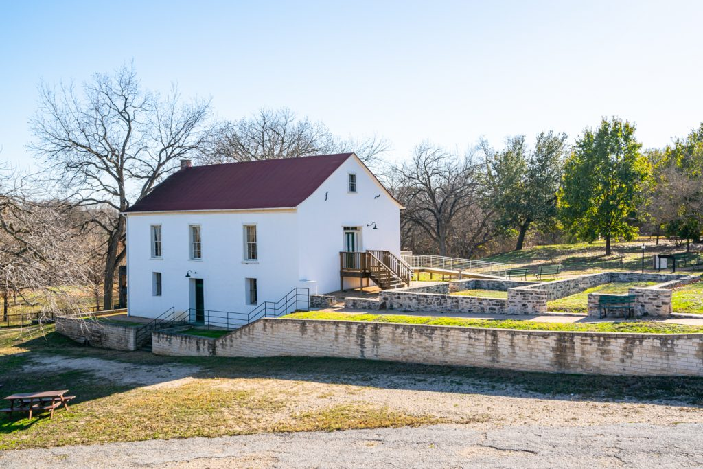 view of a white building that is part of landmark inn state historic site