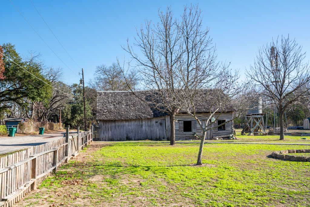 oldest one room log cabin in castroville texas on a winter day