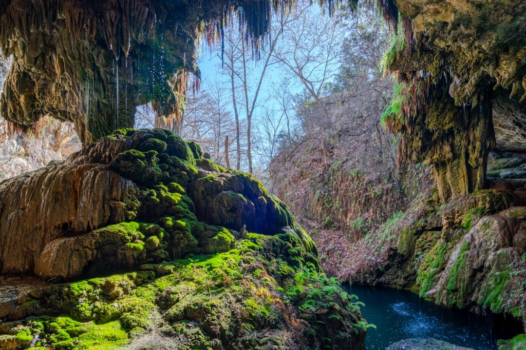 westcave waterfall in texas hill country, texas country music songs