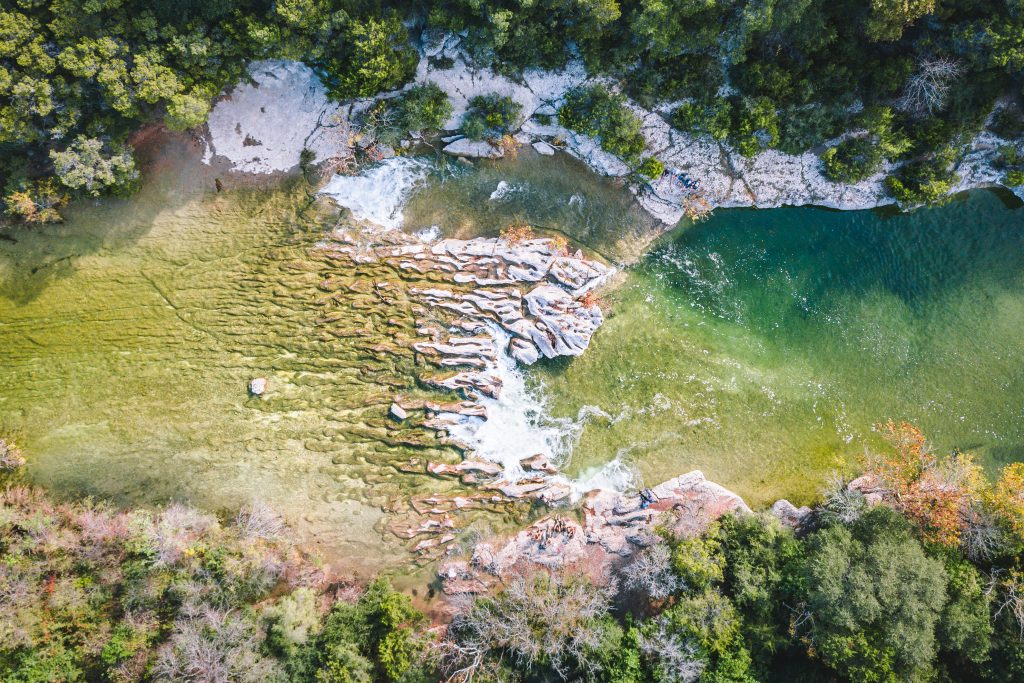 aerial view of sculpture falls, one of the best natural austin swimming holes