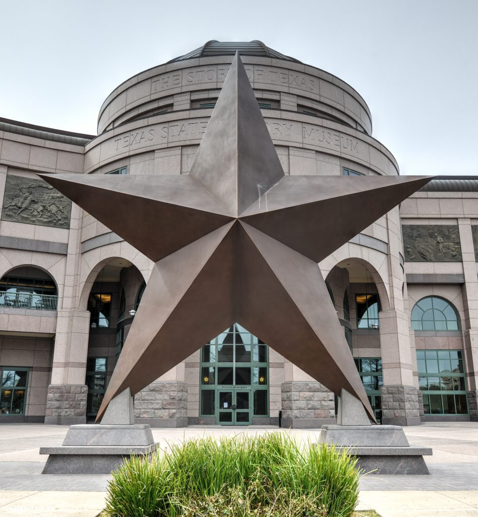 giant bronze star in front of bullock history museum, one of the best museums in austin texas