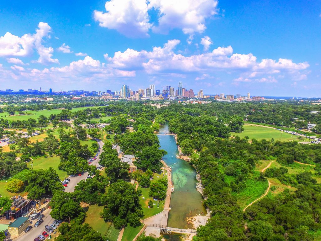 aerial view of austin texas skyline with barton springs pool in the foreground, a fun stop during a 3 day austin weekend getaway