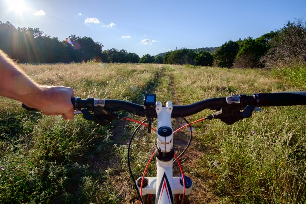 first person view of mountain biking at texas colorado bend state park