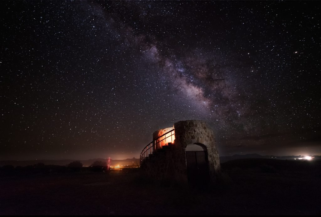 astrophotography of davis mountains state park texas with an abandoned water tower in the foreground