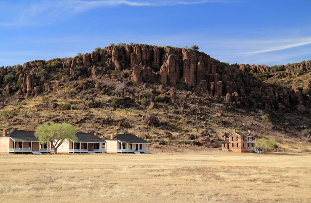 buildings of fort davis set against a rock formation, one of the best national parks in texas
