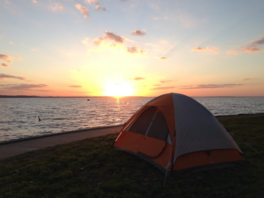 tent on the shores of lake livingston at sunset, one of the best places to camp near houston