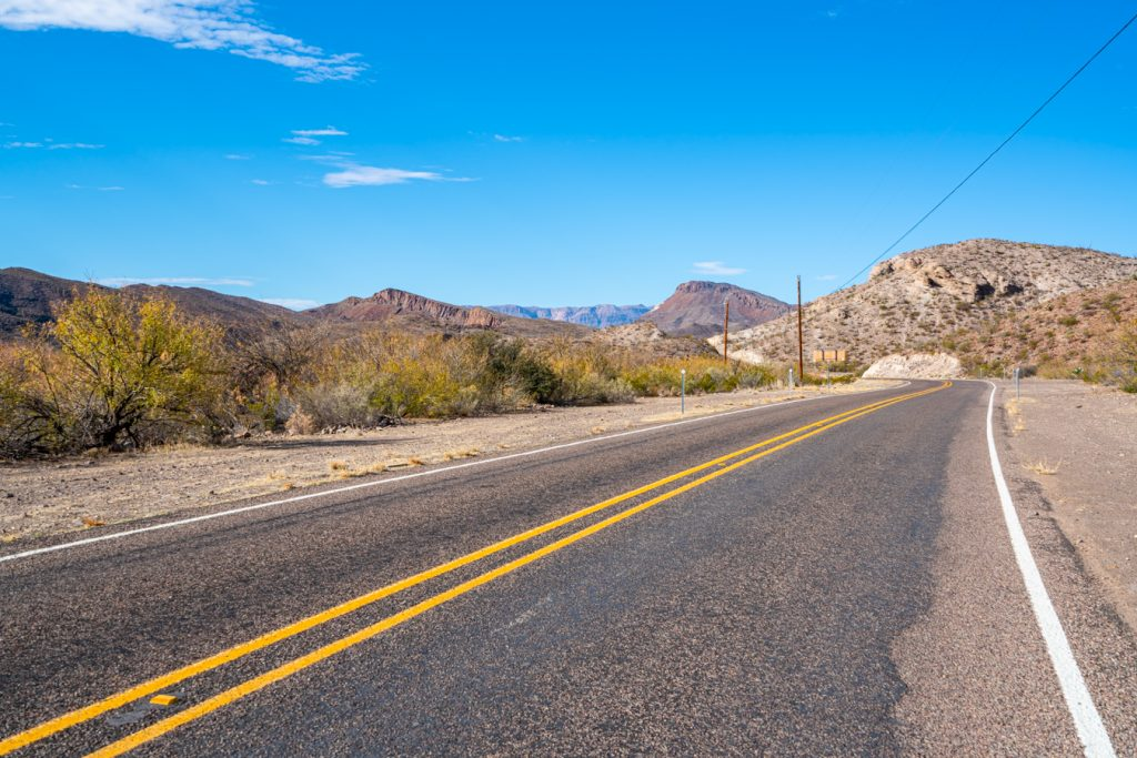 two lane road in west texas, as seen when driving from austin to big bend national park road trip