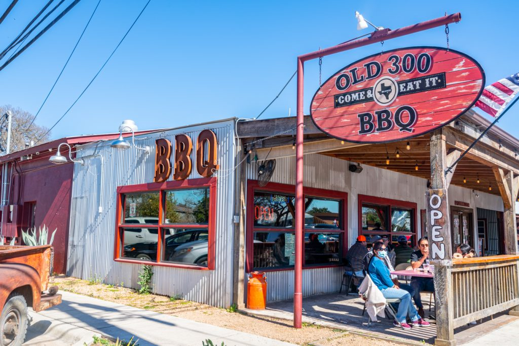 photo of old 300 bbq front porch, one of the fun things to do in blanco texas