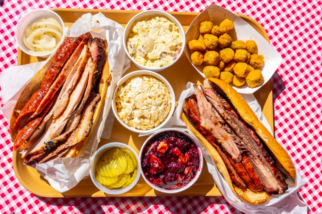 tray of texas bbq in blanco tx with 2 barbecue sandwiches on it