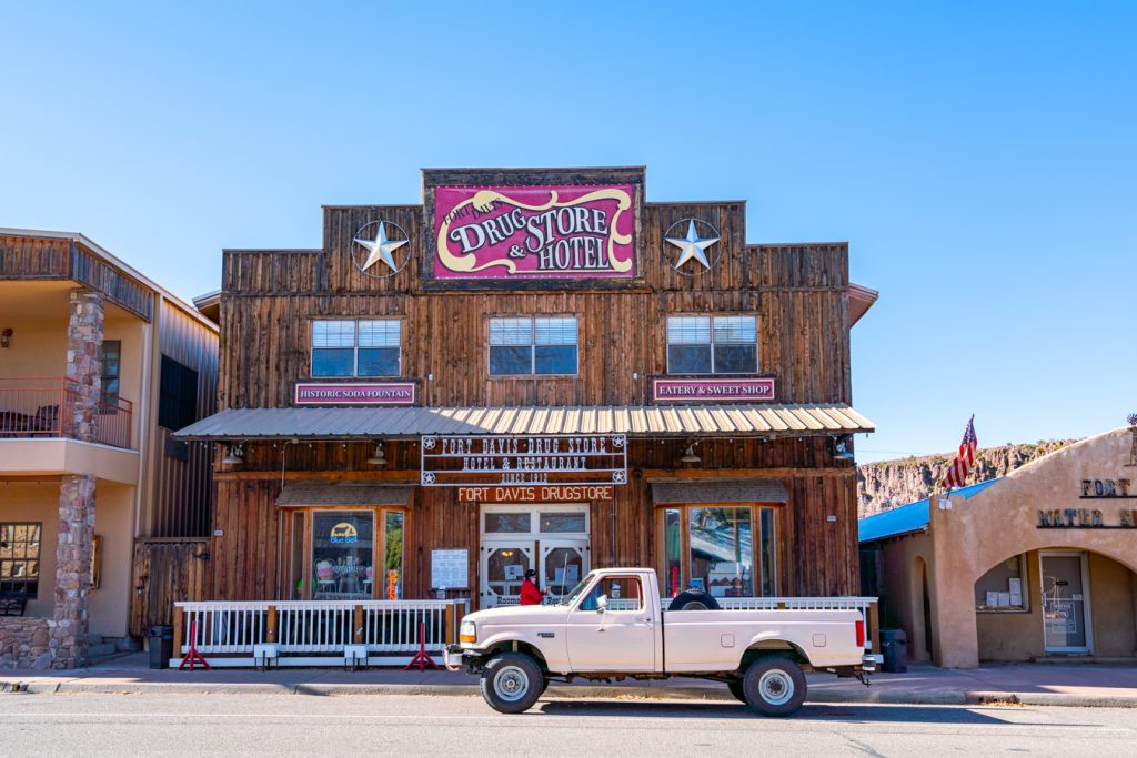 fort davis drugstore with pickup truck out front, one of the best things to do in fort davis tx