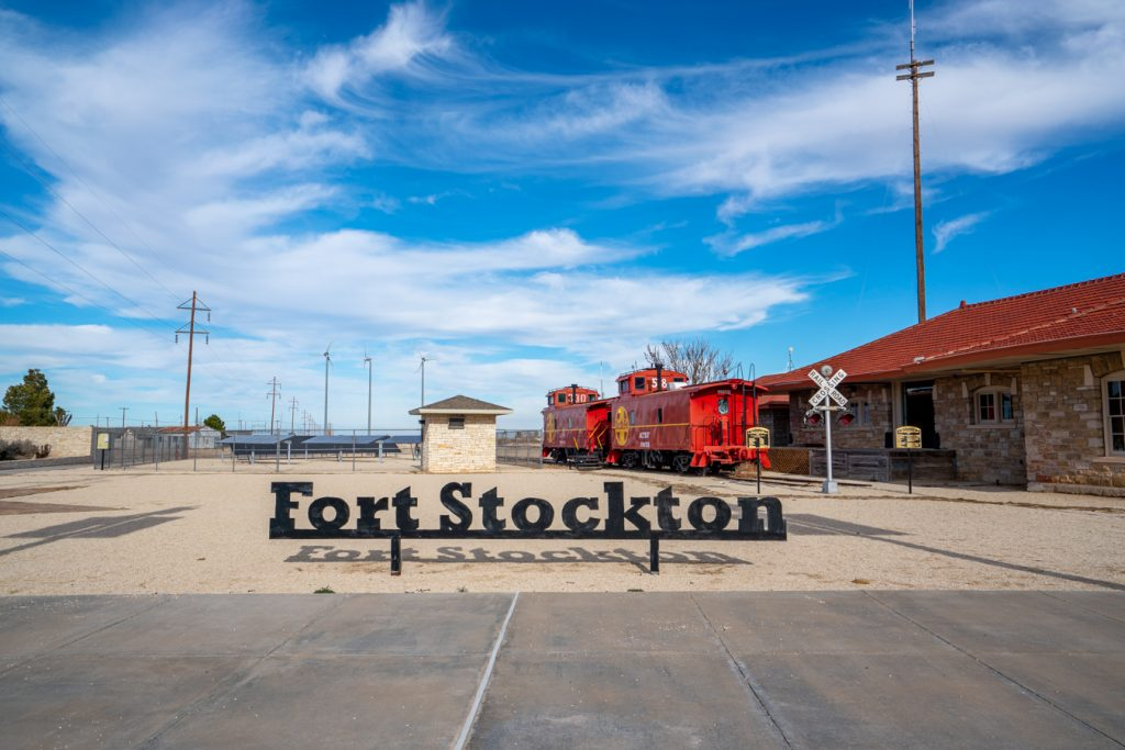fort stockton visitors center with black lettering reading fort stockton in the foreground