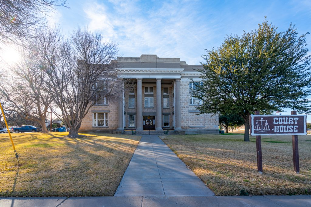 pecos county courthouses with sidewalk leading to it